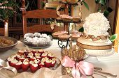 stock photo of bridal shower  - Beautiful display of cakes strawberries  - JPG