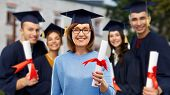 graduation, education and old age concept - happy senior graduate student woman in mortar board with poster