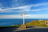 Distance Signpost At Lands End, Penwith Peninsula, Cornwall, Most Westerly Point Of England. poster
