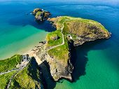 Carrick-a-rede Rope Bridge, Famous Rope Bridge Near Ballintoy In County Antrim, Linking The Mainland poster