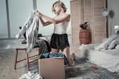 Woman Wearing Pajamas Packing Clothes Of Ex Husband Into Boxes poster