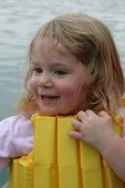 Girl In Life Vest On Lake