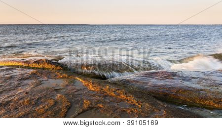 Large Brownish Rocks In Sea