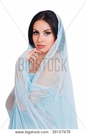 portrait of a young woman in a blue scarf
