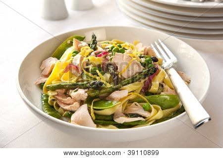 Pasta primavera with poached salmon.  Delicious, healthy eating.