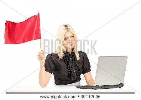 Sad female office worker waving a red flag gesturing defeat isolated on white background
