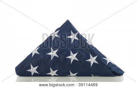 Folded US flag isolated on white