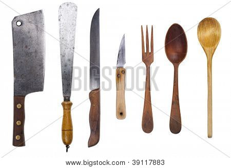 Set of rustic utensil. Cleaver, trowel, knifes, wooden spoons and fork. Isolated with clipping path.