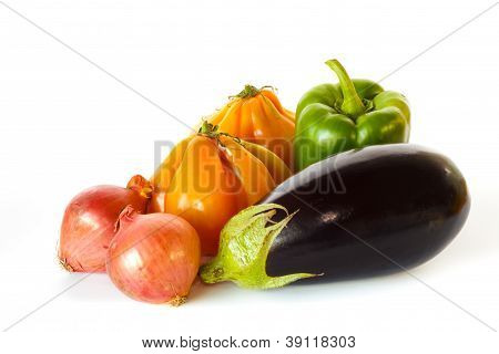 Still Of Eggplant, Pepper, Onions And Tomatoes
