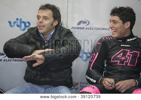 CHESTE - NOVEMBER 13: Left Loris Capirossi & Aleix Espargaro during first test of MotoGP for 2013, on November 13, 2012, in Ricardo Tormo Circuit of Cheste, Valencia, Spain