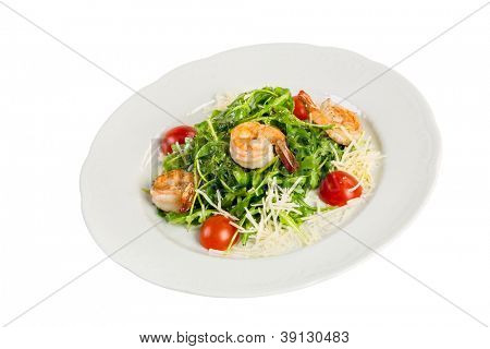 Salad from eruca and shrimps a white background