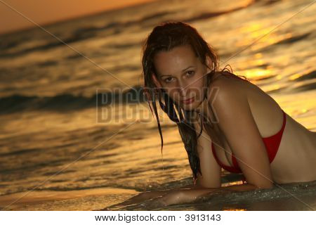 Woman On The Beach By Sunset