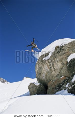 Man Jumping Off Mountain On Skis