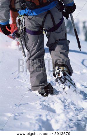 Man Mountain Climbing In Snow