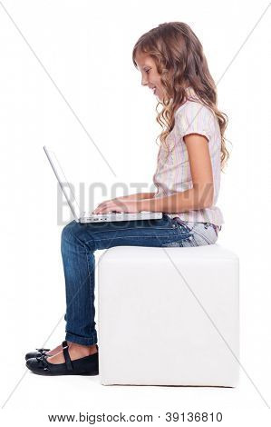 sideview of smiley girl with laptop. full length photo over white background