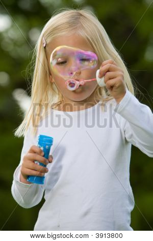 Blowing A Giant Soapbubble