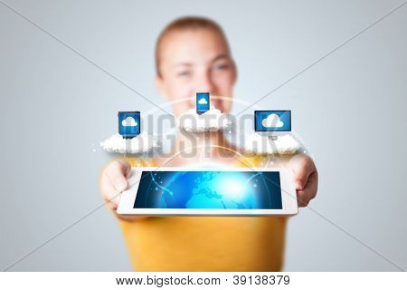 Young woman holding tablet with abstract clouds and modern devices