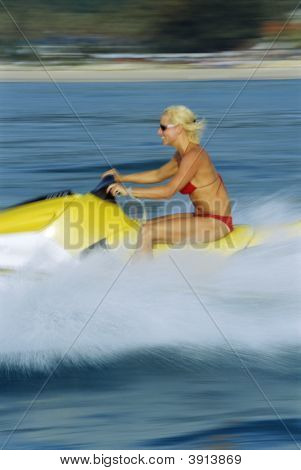 Woman Jet-Skiing Across Ocean