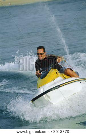 Man Jet-Skiing Fast Across Ocean