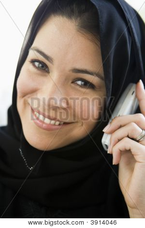 Middle Eastern Woman At Home On Cell Phone