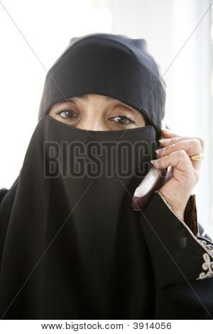 Portrait Of Middle Eastern Woman At Home On Phone