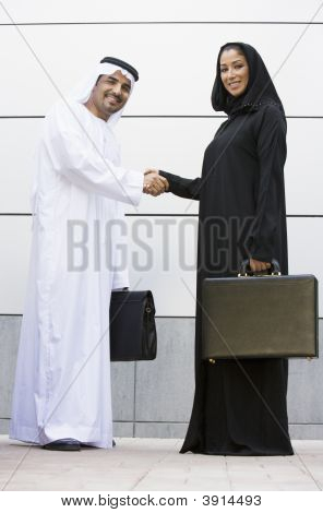 Middle Eastern Business Couple Shaking Hands