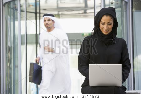 Middle Eastern Business With Woman On Laptop