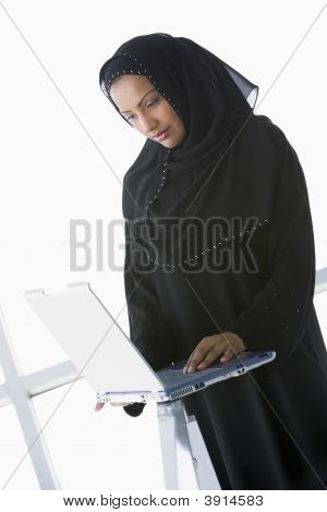 Middle Eastern Woman On Laptop