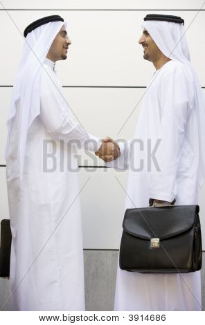 Middle Eastern Business Men Shaking Hands