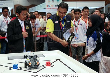 SUBANG JAYA - NOVEMBER 10: Unidentified team members prepare their robot for the competition at the World Robot Olympaid on November 10, 2012 in Subang Jaya, Malaysia.