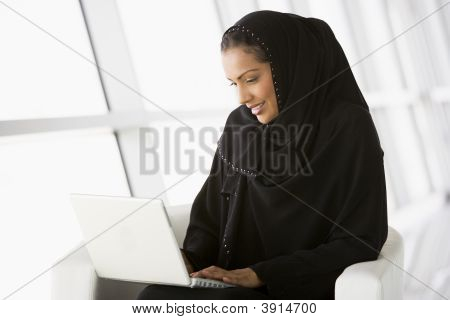 Middle Eastern Business Woman Using Laptop