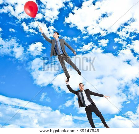 Businessmen flying in the sky