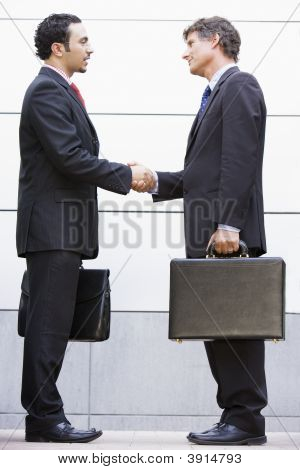 Middle Eastern / Western Business Men Shaking Hands