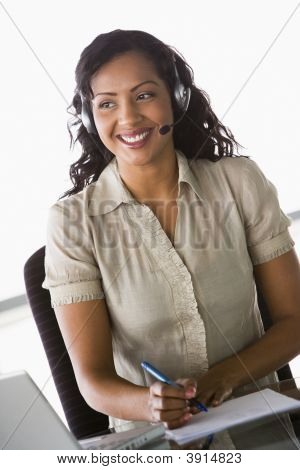 Middle Eastern Business Woman Using Laptop And Headset