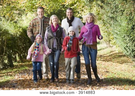 Generational Family Walking Through Woodland