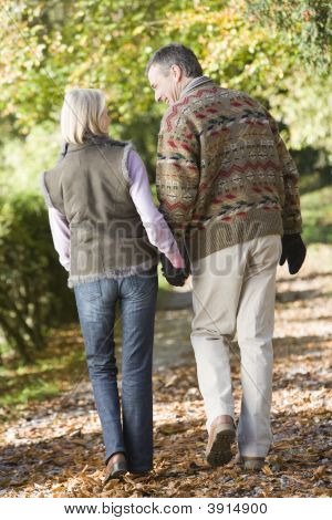 Couple Walking Through Woodland
