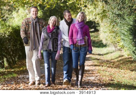 Generational Couples Walking Through Woodland