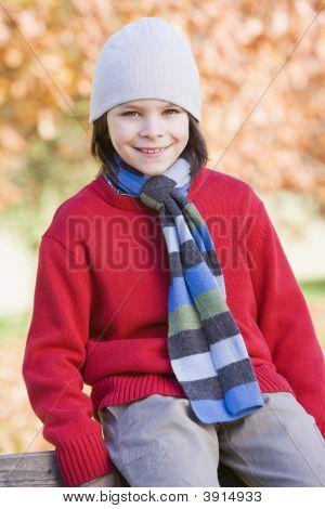 Boy Sat On Woodland Fence