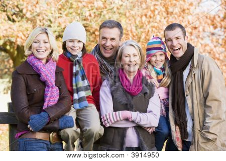 Generational Family On Woodland Fence