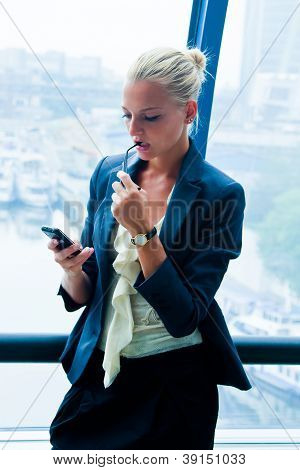 Business woman reading the SMS message
