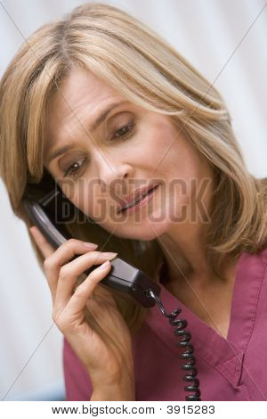 Consultant Phoning Client From Surgery With Bad News