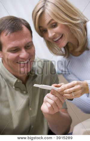 Couple Looking At Positive Home Pregnancy Test