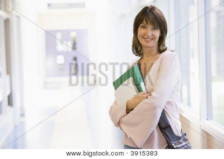 Woman Stood In School Corridor