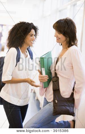Women Standing In School Corridor