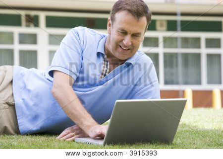 Man Using Laptop Outside School