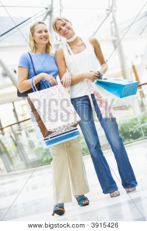 Women In Shopping Mall With Bags