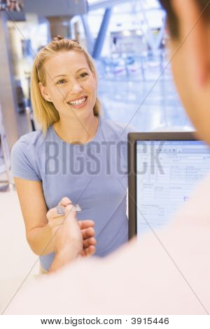 Woman Paying With Card In Shop