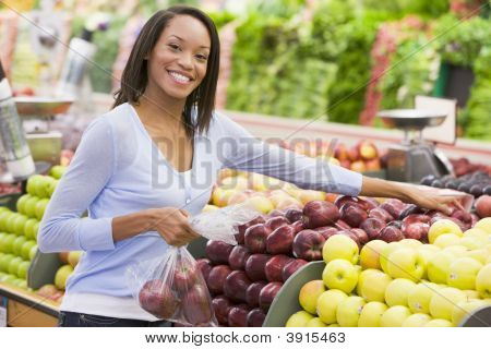 Woman Choosing Fruit In Shop