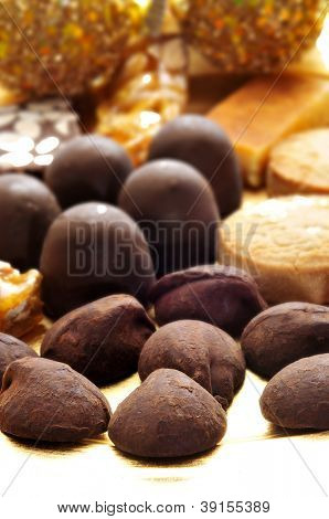 closeup of a pile of cocoa truffles, chocolates, mantecados and polvorones, typical spanish christmas sweets