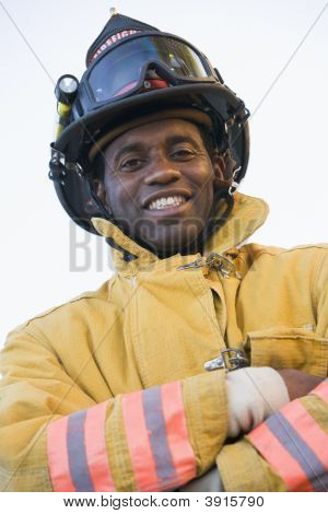 Firefighter Standing In Uniform